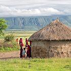 Maasai People and traditional hut by Yair Karelic