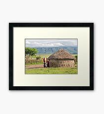 Maasai People and traditional hut Framed Print
