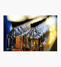 A line of Whisky blenders bottles Photographic Print