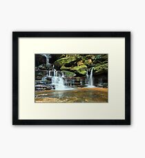 Tranquility waterfalls in lush vegetation Framed Print