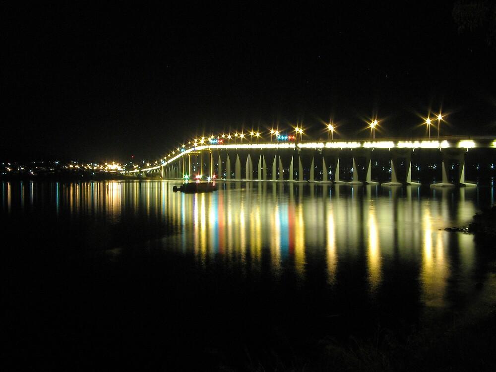 Tasman Bridge at night. by Damian Bourke