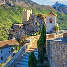 Bell tower steps and castle at Guadalest by Ralph Goldsmith