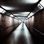 eerie long underground walkway reddish tint von Michael Hofmann