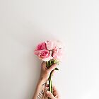 Pink roses in hands by Natalie Board