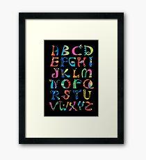 surreal alphabet black Framed Print