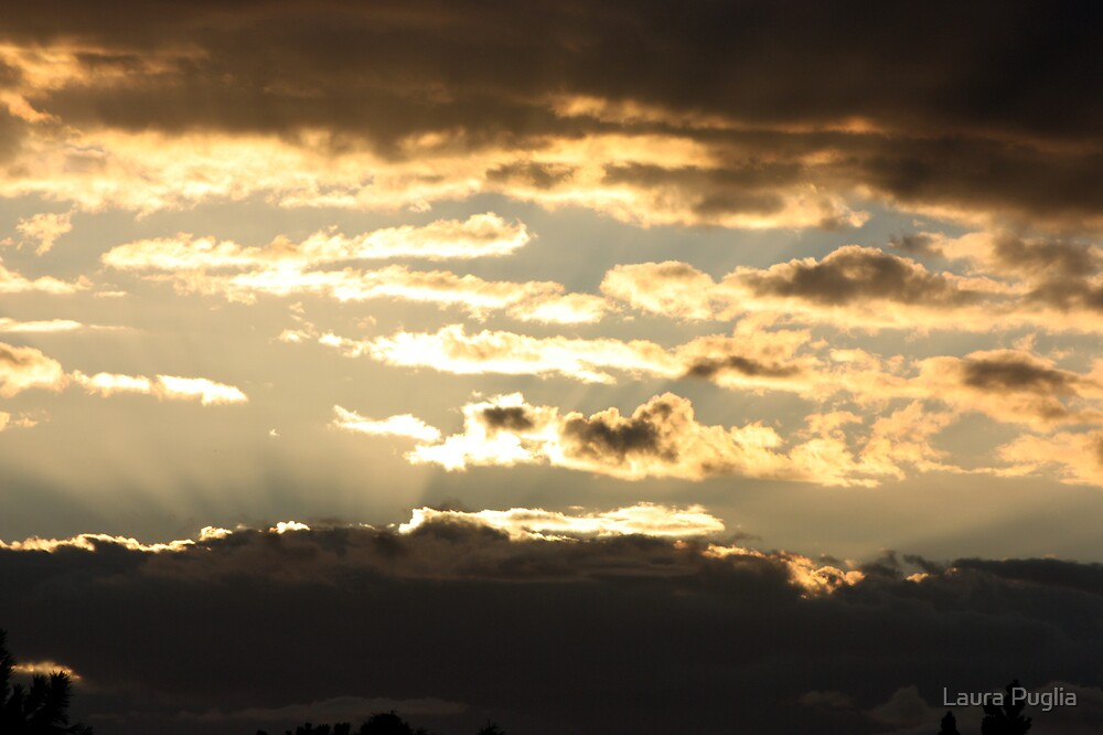 Cloudy Sunsets by Laura Puglia