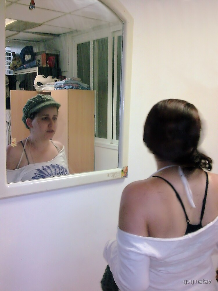 the mirror is looking back by guy natav