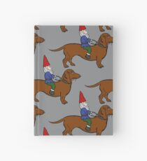 Gnome Riding a Dachshund Pattern, Gray Background Hardcover Journal