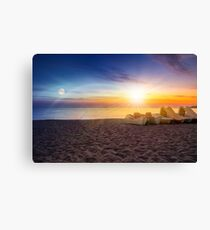 calm sunset at sea beach with boats Canvas Print
