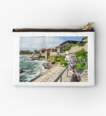 photographer with backpack shooting in old town Sozopol near sea in summer Studio Pouch