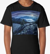 valley with conifer forest full of fog in mountain at night Long T-Shirt