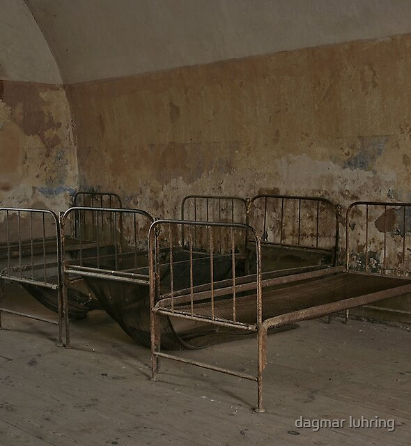beds in a  collective cell in the concentration camp in Terezin by dagmar luhring