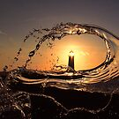 Point of Ayr lighthouse at sunset by turniptowers