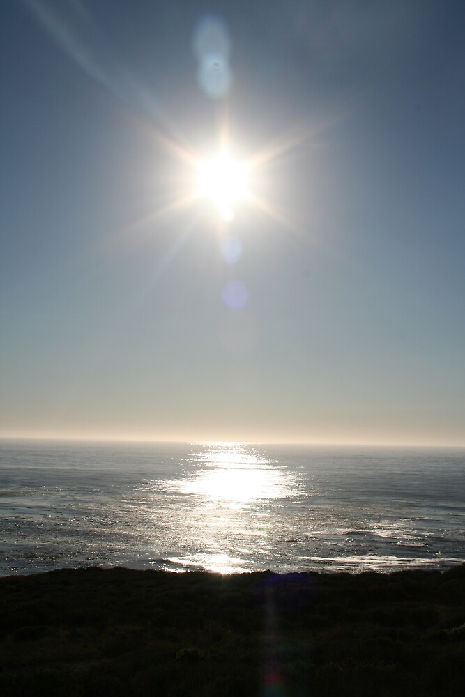 Sun between the clouds on the Pacific from Highway 1 CA by Ilan Cohen