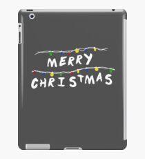 Merry Stranger Christmas Vinilo o funda para iPad