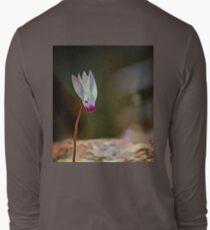 Lonely snowdrop flower on a hand drawn background. T-Shirt