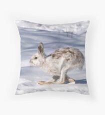 Snowshoe hare (Lepus americanus) running in the winter snow Throw Pillow