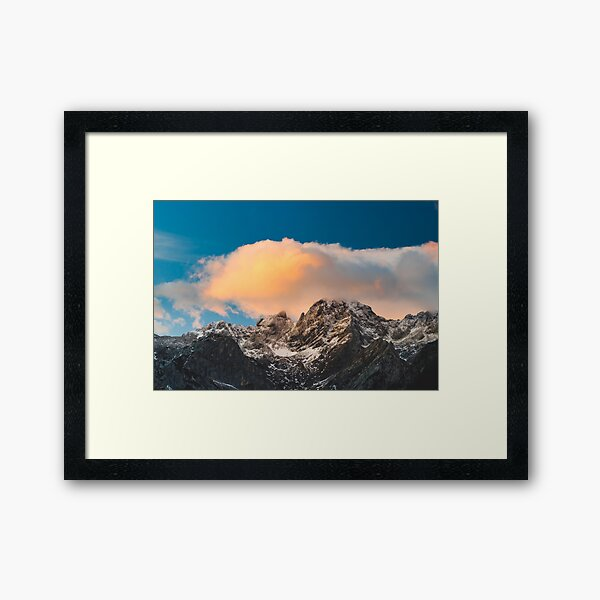 Burning clouds over the mountains  Framed Art Print