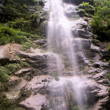 a waterfall in nepal on the anaporna trek  by hezyakri