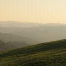 Mist over the hills by Joel McDonald