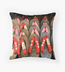 Geta Throw Pillow