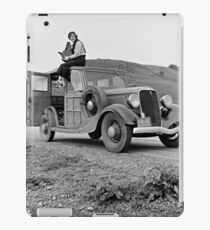 Dorothea Lange atop automobile in California. The car is a 1933 Ford Model C, 4 door Wagon. iPad Case/Skin