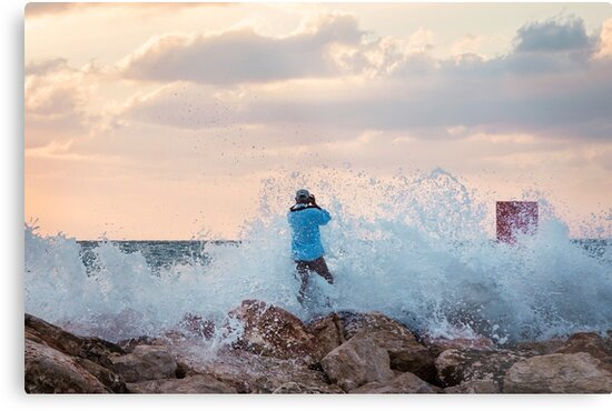 A man standing on the jetty is covered by the wave by PhotoStock-Isra