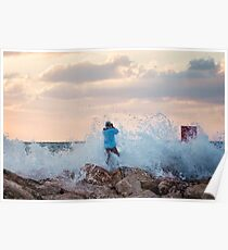 A man standing on the jetty is covered by the wave Poster