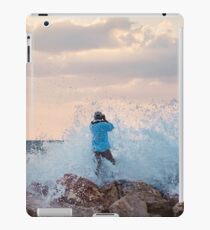 A man standing on the jetty is covered by the wave iPad Case/Skin