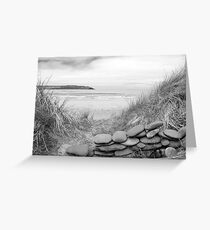 stone wall shelter on a beautiful beach in black and white Greeting Card