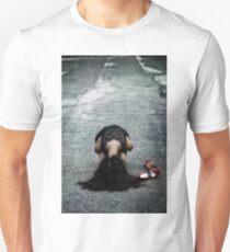 cowering T-Shirt