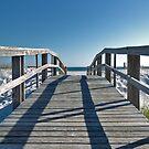 Boardwalk leading to the beach by Jeff Hathaway