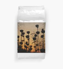 Beautiful yellow and brown Sunset over plants in Crete, Greece Duvet Cover