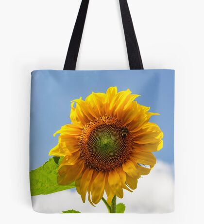 A busy bee on a Sunflower Tote Bag