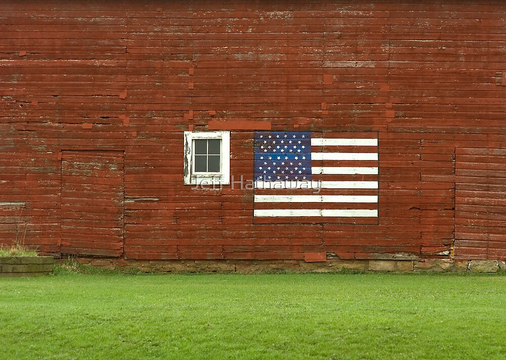 Flag on a rural farmhouse wall by Jeff Hathaway