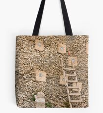 Holding wall Tote Bag