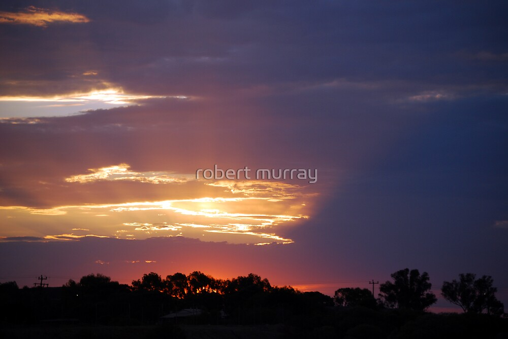 Stormy sunset by robert murray