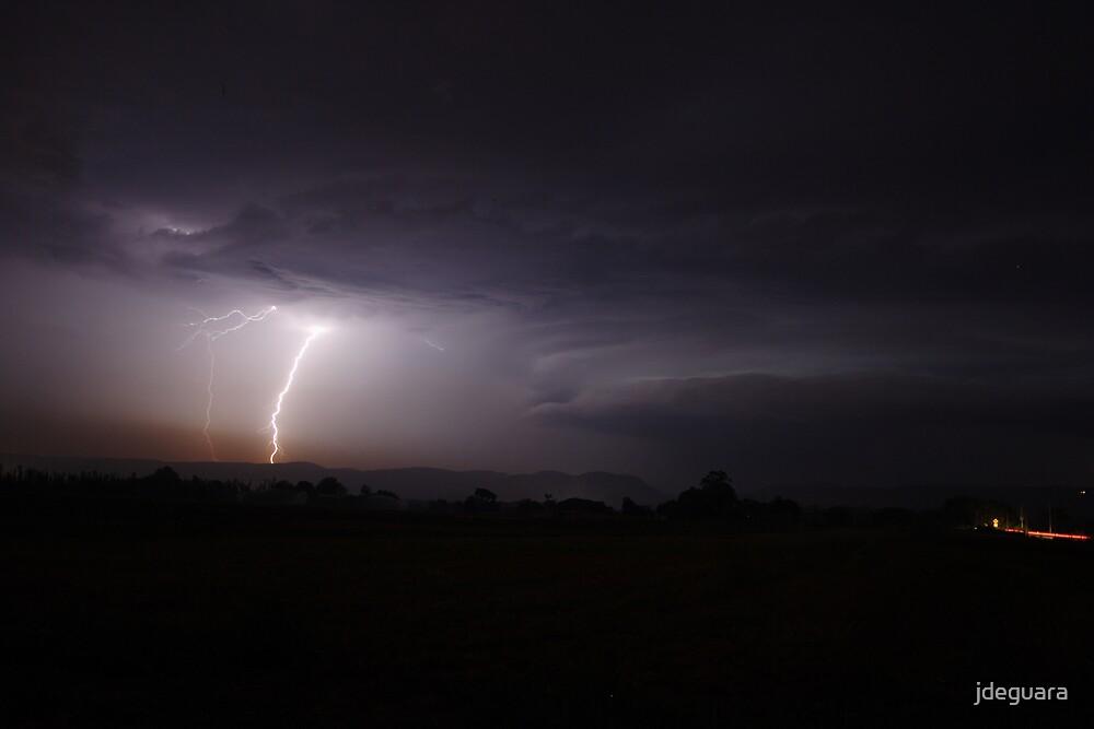 Lightning pierces the pollution haze at night by jdeguara