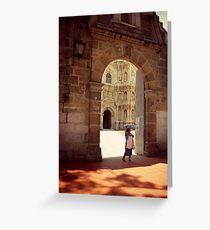 A woman carries bread through a church yard, Oaxaca, Mexico Greeting Card
