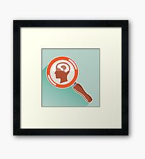 Magnifying glass and brain Framed Print