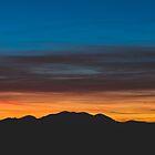 Burning sunset above landscape silhouette  by Patrik Lovrin