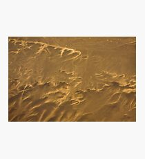 Tie dyed hearts strung in the sand Photographic Print
