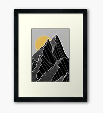 The dark peaks under the golden sun Framed Print