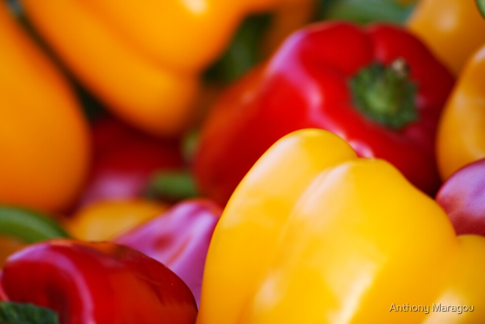 Red and yellow pepper close up by Anthony Maragou