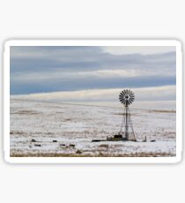 water pump  in the in the snow on a cattle ranch in Wyoming WY USA Sticker