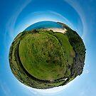 Kinnagoe Bay (as a floating green planet) by George Row