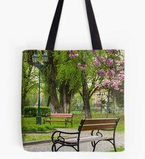wooden benches under sakura trees Tote Bag