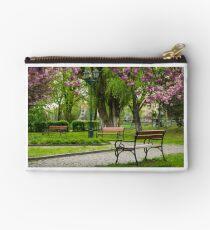 wooden benches under sakura trees Studio Pouch