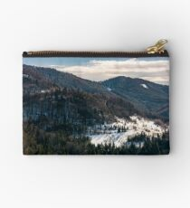 snow covered meadow among forest in mountains Studio Pouch