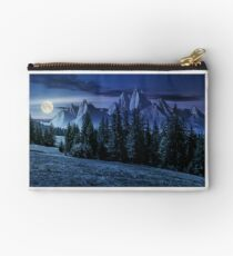 forest in mountains with rocky peaks at night Studio Pouch